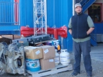 Fred standing beside our gear in front of the Polar Shelf warehouse just before it is loaded on the Twin Otter